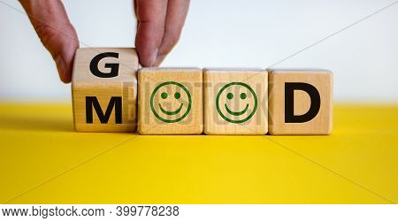 Good Mood Symbol. Male Hand Flips A Wooden Cube And Changes The Word 'good' To 'mood'. Positive Smil