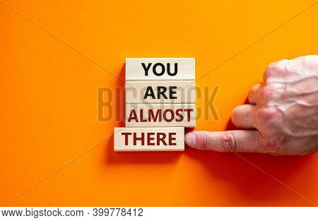 You Are Almost There Symbol. Wooden Blocks Form The Words 'you Are Almost There' On Beautiful Orange