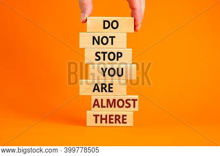 You Are Almost There Symbol. Wooden Blocks With Words 'do Not Stop You Are Almost There'. Male Hand.