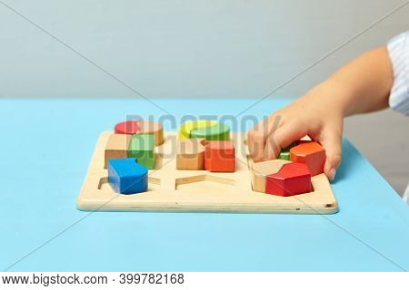 The Child Collects A Sorter. Educational Logic Toys For Kid's. Children's Hands Close-up. Montessori