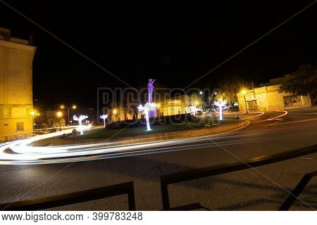 These Are Christmas Lights By The Sclpture «carmo» In Carmona, Seville, Witrh The Treaffic In Full S