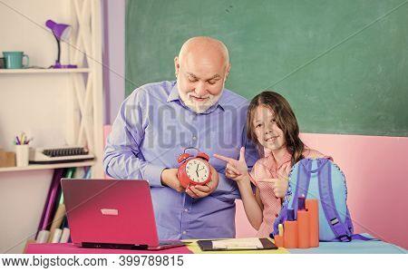 Time Management. Break Alarm. Morning. Small Girl With Man Tutor Study On Computer. Education Bloggi