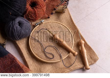 Flat Lay Composition Of Punch Needle Tools On A Concrete Surface In Warm Tones. Different Sizes Of N