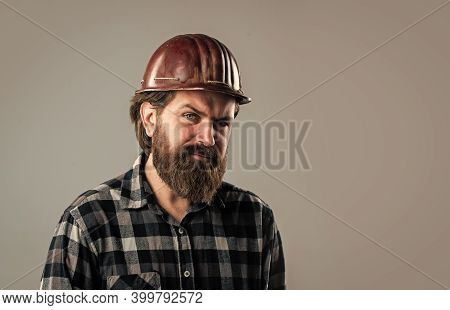 Examining. Engineer In Working. Construction Worker Wear Safety Helmet. Wearing Safety Gear. Supervi