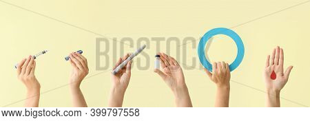 Female Hands With Insulin, Syringes, Blood Drop And Blue Ring On Color Background. Diabetes Concept