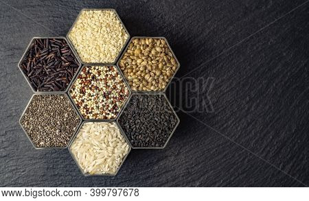 Various Cereals And Grains In The Hexagonal Shaped Honeycomb Jars