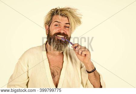 Man In Underwear. Hygiene. Man In Terry Bathrobe Brush Teeth In Bathroom. Mature Man Wear Bathrobe R