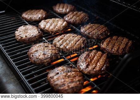 Hamburgers Grill On Backyard Barbecue