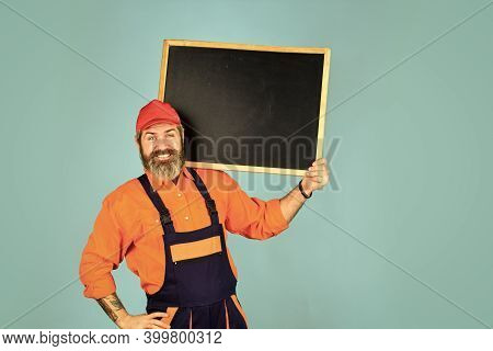 Repairman Worker. Man Worker Hold Chalkboard Copy Space. Electrician Plumber Handyman. Construction