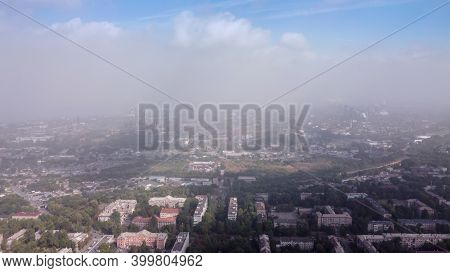 Smog Over The City, Bird Eye View. Aerial View Of Smog. Cities And Industrial Smoke Clouds The Sky.