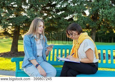 Female Social Worker, Psychologist, Journalist, Recording Interviewing Teenage Student. Women Sittin