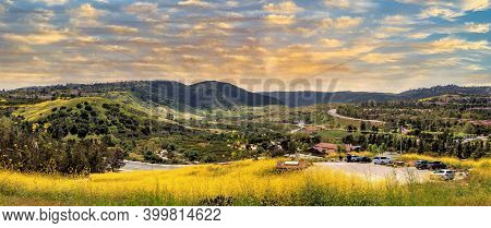 Sunset Over Aliso Viejo Wilderness Park View With Yellow Wild Flowers And Green Rolling Hills From T