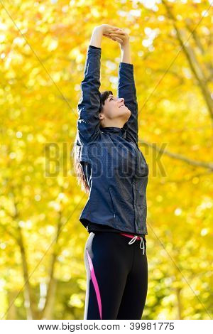 Woman In Shape Exercising Outside