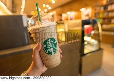 Jakarta, Indonesia : July-19-2018 : Someone Hand Holding A Cup Of Java Chip Frappuccino In Starbucks