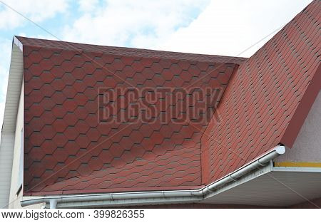 A Roofing Construction, Corner Roof, Roofing Problem Area With A Rain Gutter Covered With Asphalt Sh
