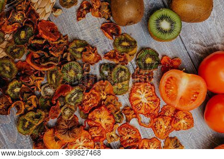 Fruit Chips In The Jar With Fresh Fruits On The Wooden Table. Chips For Fruit Leather. Healthy Food.