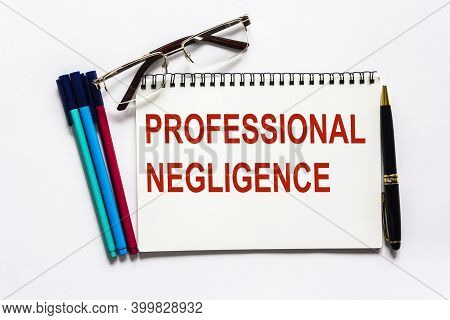 The Text Professional Negligence Is Written On A Notepad And A White Background, Felt-tip Pens And G