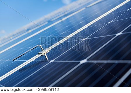 Close Up Of New Solar Photovoltaic Panel System With Blue Sky On Blurred Background. Solar Module Fo