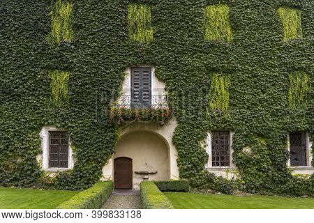 Brixen, Italy - October 9, 2020: Garden With House With Green Climber, Vine, In The Monastery Of Abb