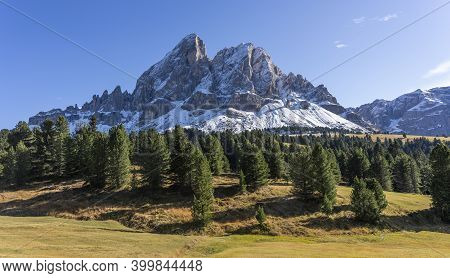 Mountain With Snow In Autumn, Sas De Putia, In The Dolomties, Italy With Fir Forest And Maedow.