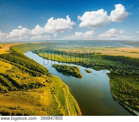 Attractive aerial top view of the sinuous Dniester River. Location place Dnister canyon of Ukraine, Europe. Aerial photography, drone shot. Picturesque photo wallpaper. Discover the beauty of earth.