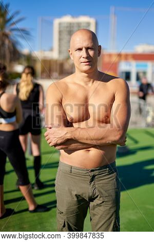 Portrait Of A Man Seminude On A Street Spot.workout Lifestyle Concept.