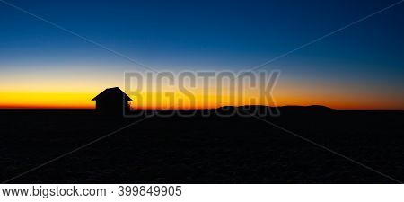Old Barn On The Field In The Blue Hour.