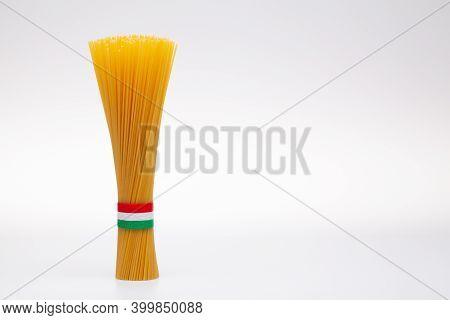 Bundle Of Spaghetti And Italian Flag On The White Background.
