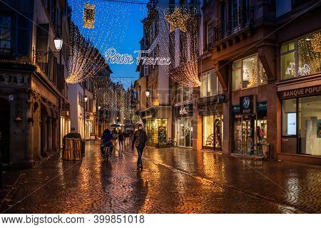 Strasbourg, France - Dec 4, 2020: Petite France Inscription Above The Street - Multiple Illumination