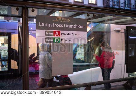 Strasbourg, France - Dec 4, 2020: People Wearing Respiratory Masks At The Tramway Station Langstross