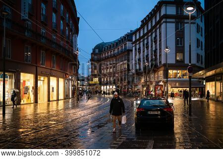Strasbourg, France - Dec 4, 2020: Man Wearing Respiratory Mask On The Almost Empty Street Due To Cov