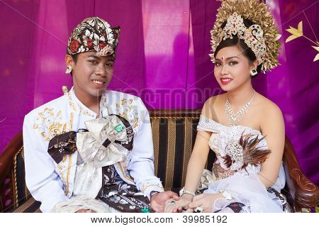 BALI - FEBRUARY 11. Couple enacting wedding scene in preparation for religious ceremony on February 11, 2012 in Bali, Indonesia. Most Balinese get married in their early 20s.