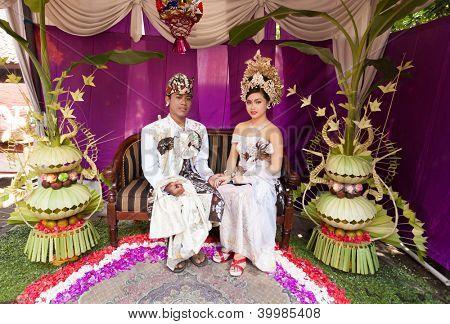 Couple enacting wedding scene in preparation for religious ceremony