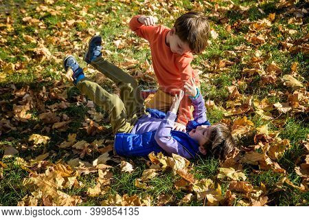 Two Boys Fighting Outdoors. Friends Wrestling In Summer Park. Siblings Rivalry. Aggressive Kid Hold