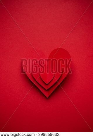 Big Voluminous Red Heart Cut From Paper On Red Monochrome Background, Paper Craft Origami Style, Fro