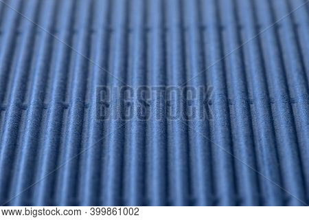Background Made Of Blue Corrugated Cardboard With Vertical Stripes, Shallow Depth Of Field.