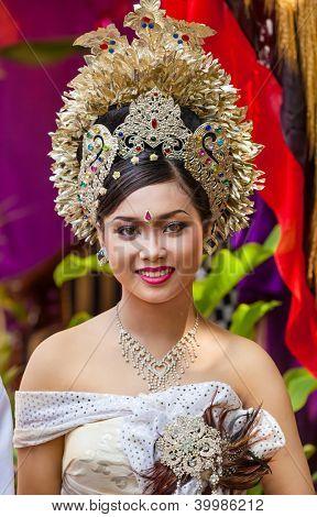Woman enacting wedding scene in preparation for religious ceremony