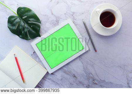 Top View Of Digital Tablet With Office Suppliers On Table