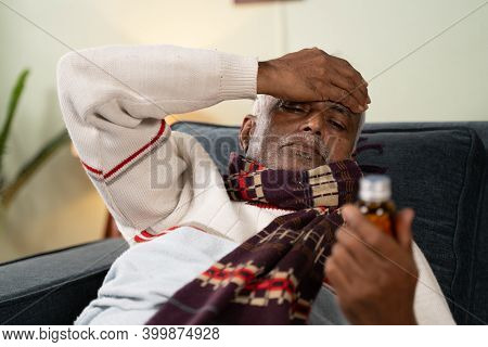 Sick Old Man Worried About Taking Pills By Placing Hand On His Head While Sleeping On Sofa Ta Home -