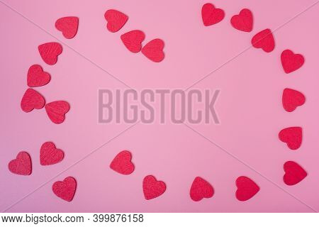 The Background Of Valentine's Day. Small Red Hearts On A Pink Background.