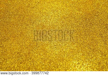 Gold Glitter Selective Focus. Christmas Abstract Background. Defocused Lights Texture. Abstract Boke