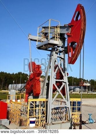 Working Pump Jack Pulling Crude Oil Out Of An Oil Well