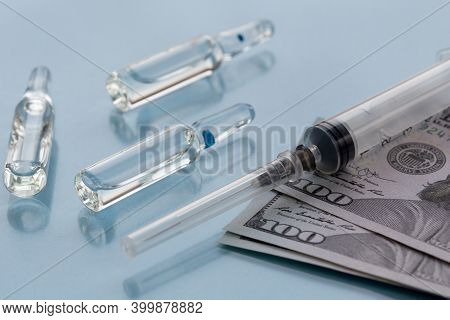 Three Ampullas, Expendable Syringe For Vaccination And Paper Money. Coronavirus Vaccination Concept.