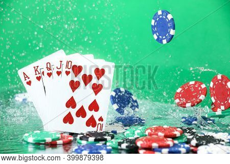 Royal Flush combination under the water drops against green background. Online gambling. Betting. Gambling addiction.