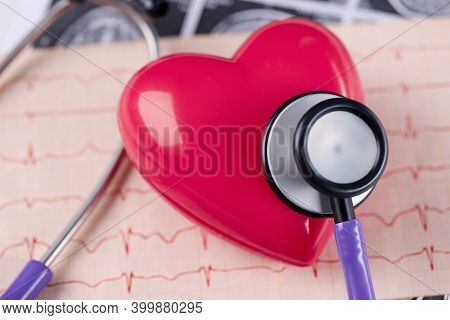 On Table Lies Cardiogram Heart And Stethoscope. Examination In The Field Of Cardiology Concept