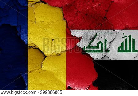 Flags Of Romania And Iraq Painted On Cracked Wall