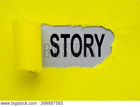 On A Gray Background Written Story, Through A Hole In The Yellow Paper, Business Concept For The Act