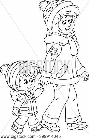 Young Mom And Her Little Daughter Friendly Talking And Walking Together Hand In Hand On A Winter Str