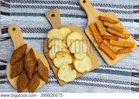 Different Types Croutons On Wooden Boards Close-up, White, Brown, Dark