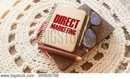 Direct Marketing Words On Coer Of Notebook, Glasses And Pen. Business Concept